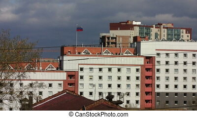 office building with Russian flag on the roof