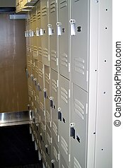 White Lockers - White lockers in a small hallway for the use...
