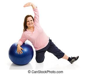 Plus Sized Pilates - Beautiful plus sized model exercising...