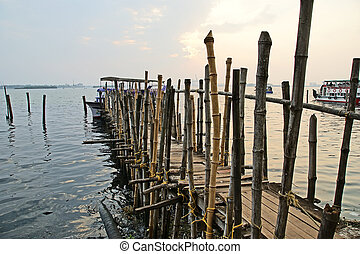 The old pier for boats made ??of bamboo, Cochin, Kerala,...