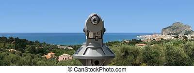 telescope viewer and panoramic view of the Cefalu. Cefalu is a delicious historic and turistic town in the Palermo's area. Sicily, Italy.