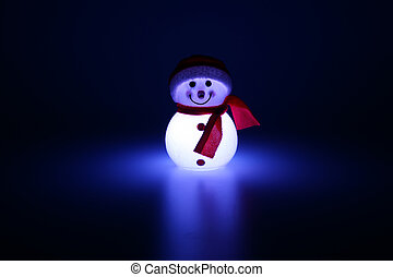 Glowing from within snowman. Christmas decoration