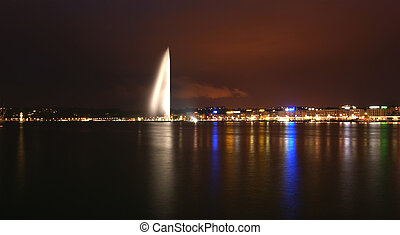 Switzerland, Geneva, night view of Lake Geneva and the city