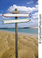 Directional sign  - Double directional signs on a beach