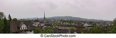 Switzerland, Zurich, panoramic view of the city on a foggy spring weather