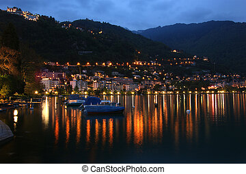 Switzerland, Montreux, a night view of Lake Geneva and the...