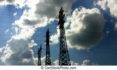 High voltage tower on cloudy sky