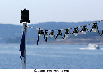 garland of signal lights at sea aboard the yacht