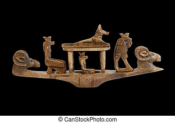 sculpture of the Egyptian gods on the boat