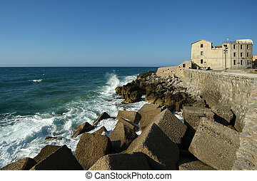 View of the Cefalu waterfront. Cefalu is a delicious historic and turistic town in the Palermo's area. Sicily, Italy.