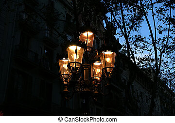 Street lamp at twilight in Barcelona near Las Ramblas....