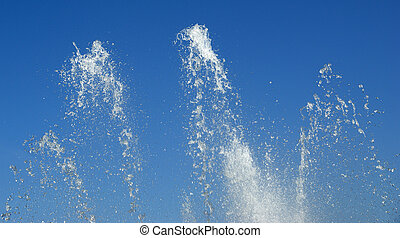 Sparks of water against the blue sky