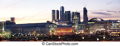 Moscow, Russia. Night. View from the embankment of the Moskva River in the Kievsky train station, international business centre and pedestrian bridge Bogdan Khmelnitsky