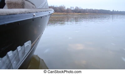 Motor boat - Profile view of the Motor boat splashing the...