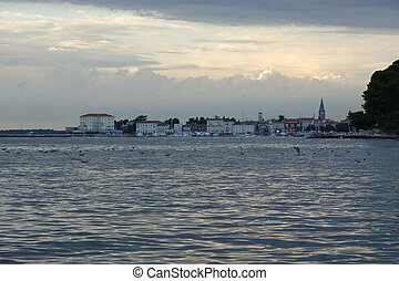 Sea view and city in the sunset time, Croatia, Porec