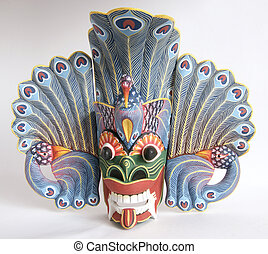 Traditional Indonesian Balinese mask-souvenir from a tree on...