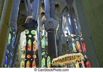Inside of Sagrada Familia in Barcelona, Spain. Designed by...