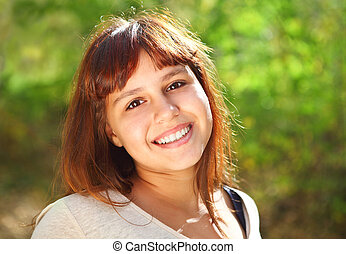 Happy smiling teen girl outdoors