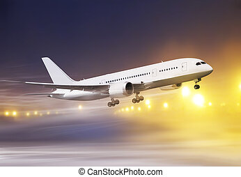 plane in snowstorm - airport and white plane taking off at...