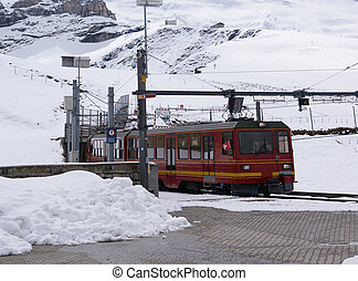 The train that runs from Kleine Scheidegg to the top of...