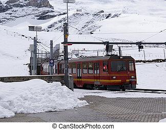 The train that runs from Kleine Scheidegg to the top of...