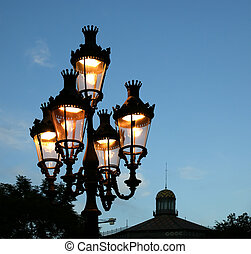 Street lamp at twilight in Barcelona near Las Ramblas...