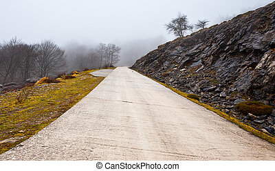 Mountain Pass - Fog on the Paved Road through a Mountain...