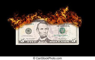 Burning five dollar bill symbolizing careless money...