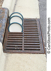 Drying Plates - Plates drying in a storm drain grate.