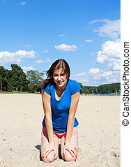 cute girl sitting on the beach