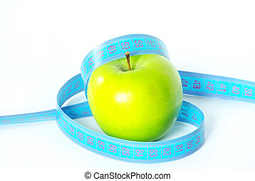 green apple - Green apple and measuring tape on white