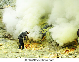 mine worker working in the indonesian sulfur mines kawah...