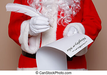 Santa Claus checking his list - Santa Claus holding a quill...