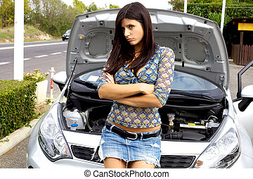 Beautiful woman sad with broken car in middle of street -...