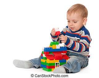 Kid building a toy house