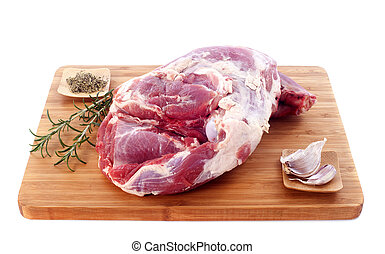 raw shoulder of lamb on a cutting board