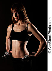 Young fit girl working out with weights - Portrait of pretty young woman lifting dumbbells during exercising