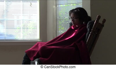 Relaxing in Rocking Chair - Teen girl rocking in rocking...