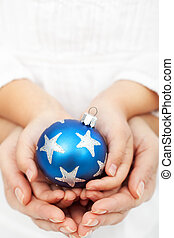 Hands holding christmas bauble