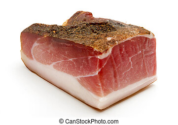 Speck juniper-flavored ham originally from Tyrol on a white...