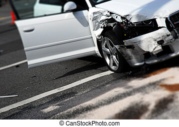 Car Accident Aftermath - A white car after and accident with...