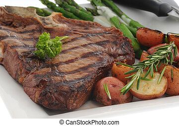 T-Bone Steak - Perfectly grilled t-bone steak with roasted...