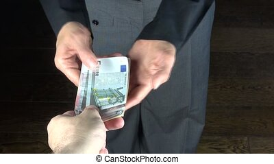 business trousers counting money - hands of woman with grey...