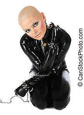 Slave - Bold slim woman in black latex catsuit and collar...