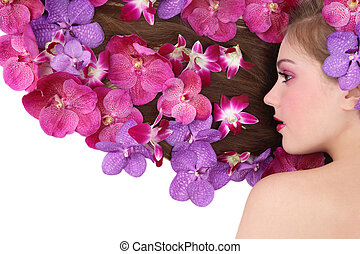 Orchid hairstyle - Beautiful girl lying on white background...