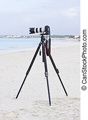 digital slr camera on tripod on beach in summer outdoor