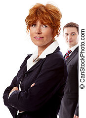 red head woman in business outfit front man background - red...
