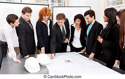 business team looking architecture project in office