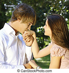 young man kissing woman\\\'s hand - handsome boy kissing a...