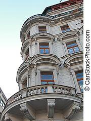 Windows on corner of European historic building in Prague city center
